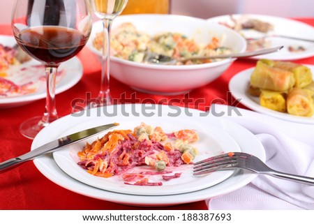 Table with festive dishes after feast close-up - stock photo