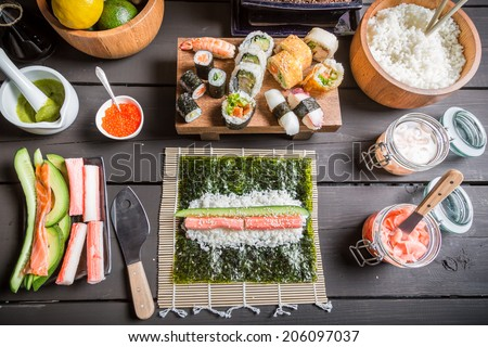 Table with ingredients for sushi - stock photo