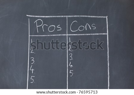 Table with numbers opposing pros and cons on a blackboard - stock photo