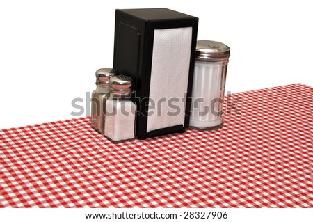 Table with red gingham tablecloth at diner.  Isolated on white background with clipping path. - stock photo
