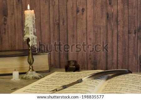 Table with the ancient book of human anatomy - stock photo