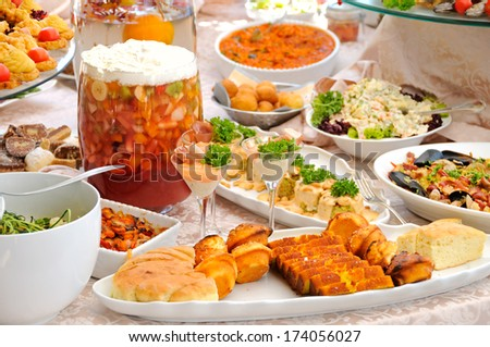 Table with variety of food - stock photo