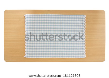 Tablecloth on wooden table isolated on white background - stock photo