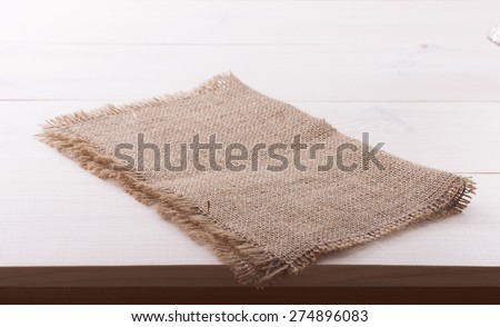 Tablecloth textile on white wooden table - stock photo