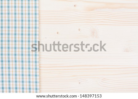 Tablecloth textile texture and wooden table background - stock photo