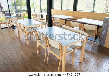 Tables And Chair In Empty Cafe, restaurant, fast food and coffee shop - stock photo