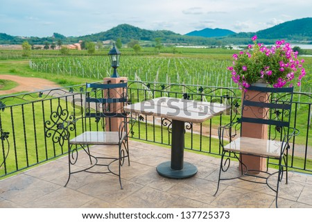 Tables and chairs outside the winery field - stock photo
