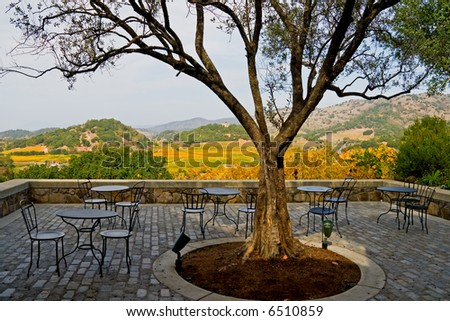 Tables and chairs outside the winery in Napa Valley in Autumn at sunset - stock photo