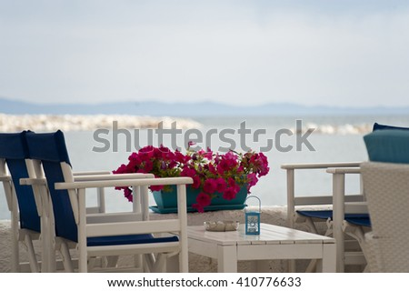 Tables and chairs ready for customers on a balcony - stock photo