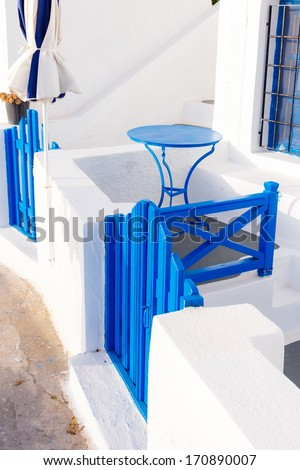 Tables and chairs ready for customers on a balcony at Fira, Santorini, Greece  - stock photo