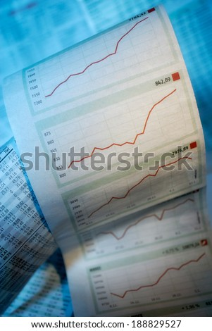 Tables and charts with stock prices - stock photo