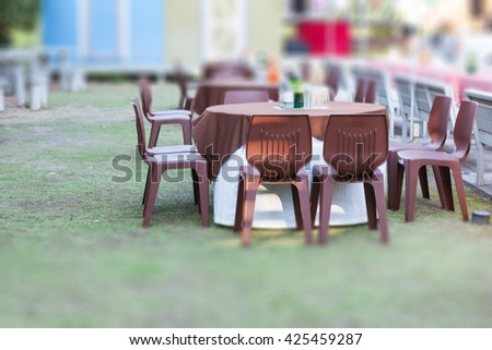 Tables decorated for a party or wedding reception in the park - stock photo