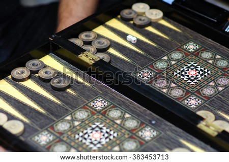 tables game - backgammon and dices - stock photo