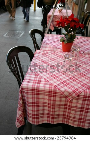 Tables of restaurant on a city sidewalk - stock photo