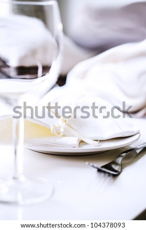 Tables set for meal in restaurant close up - stock photo