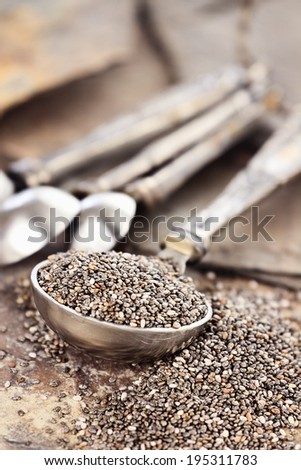 Tablespoon of healthy chia seeds with selective focus and extreme shallow depth of field. - stock photo
