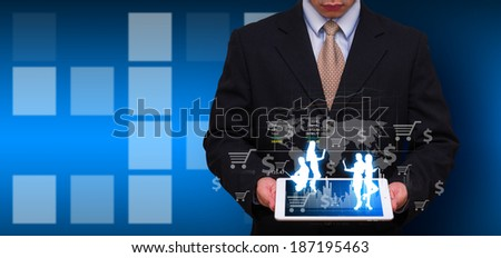 Tablet and business man  - stock photo