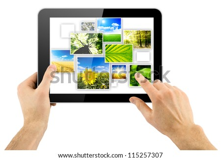 tablet computer and collage of natural photo in a hand isolated on white background - stock photo