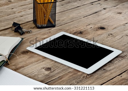 Tablet computer in the workplace. Closeup. Top view. Copy space. Free space for text - stock photo