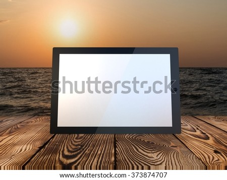 Tablet computer on sea background - stock photo