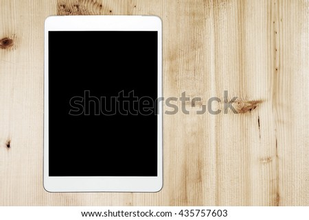 Tablet Computer On Wood Background. - stock photo