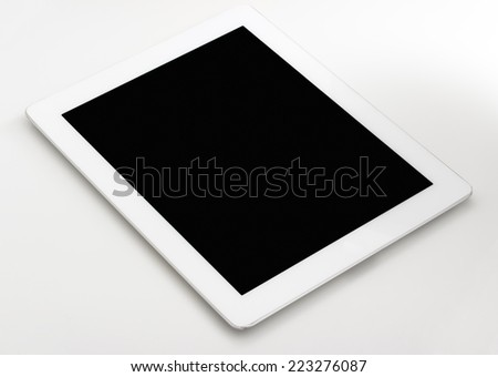 Tablet computer on your desktop bright light - stock photo