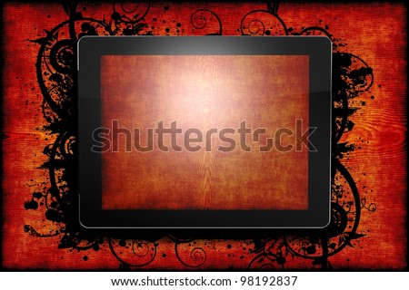 Tablet Computer Red Wood Theme. Tablet Displaying Wood Texture on the Wood Background. Black Floral Elements. - stock photo