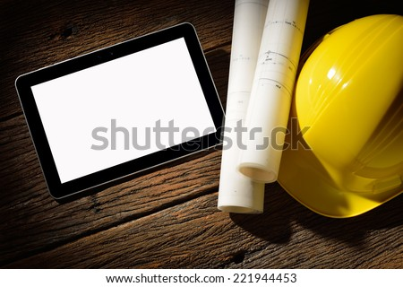 Tablet computer with architecture and construction tools and blueprints - stock photo