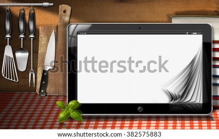 Tablet computer with blank pages and a stack of books in a kitchen with utensils. Template for recipes or food menu - stock photo