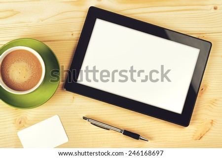 Tablet Computer With Blank White Screen as Copy Space on Office Table. - stock photo