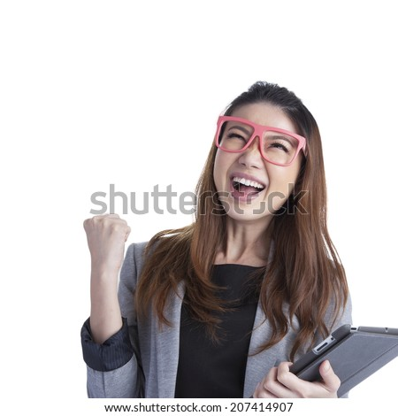 Tablet computer woman winning happy excited. Tablet computer woman excited looking at touch pad pc. Cheerful happy fresh Asian Caucasian female model isolated on white background - stock photo