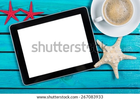 Tablet. Digital tablet and coffee cup on wooden table - stock photo