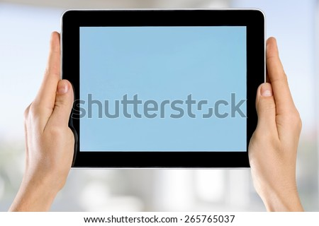 Tablet. Female hands holding a tablet touch computer gadget with isolated screen - stock photo