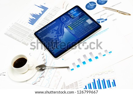 tablet, financial documents and a cup of coffee, still life showing modern technologies in business - stock photo