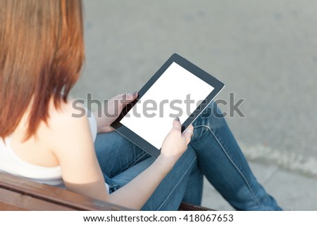 Tablet in girls hands - stock photo