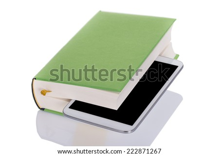 Tablet inside book. Isolated on white background - stock photo