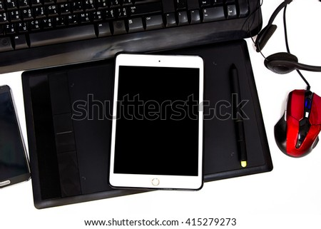 Tablet, mobile phone and touch pad on the table. - stock photo