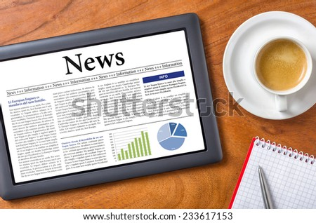 Tablet on a desk - News - stock photo