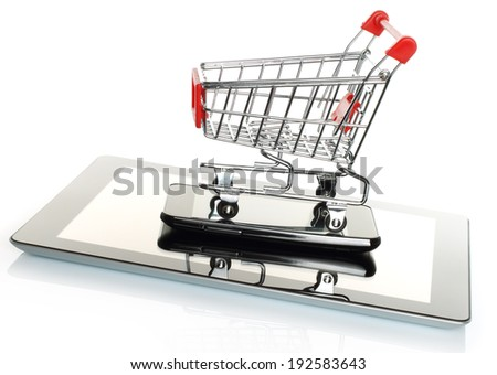 Tablet PC and smart phone with shopping cart on white background   - stock photo