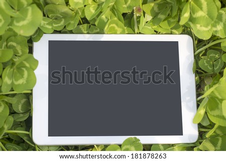 Tablet PC clover - stock photo