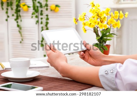 Tablet PC in the hands of the girl manager - pure touch screen - stock photo