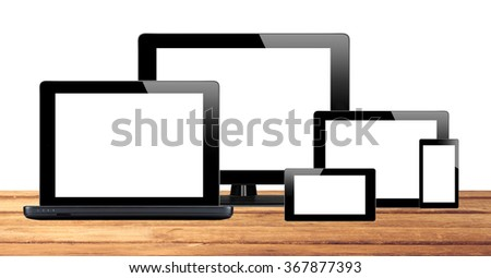 Tablet pc, mobile phone and computer on table isolated on white background - stock photo