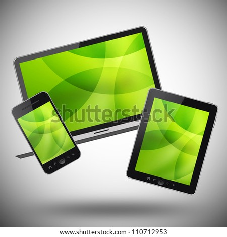 Tablet pc, mobile phone and notebook on gray background - stock photo