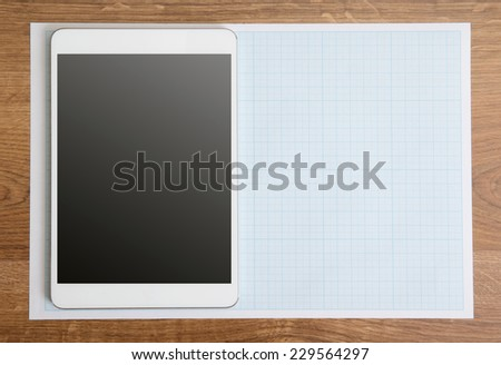 Tablet PC notebook and pen on the table  - stock photo