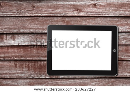 Tablet pc on wooden background - stock photo