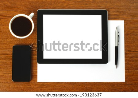 Tablet PC, smart phone, paper, pen and cup of coffee on wooden background - stock photo