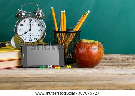Tablet pc, smartphone and different schoolchild and student studies accessories. Back to school concept. - stock photo