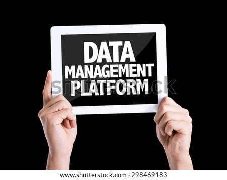 Tablet pc with text Data Management Platform isolated on black - stock photo