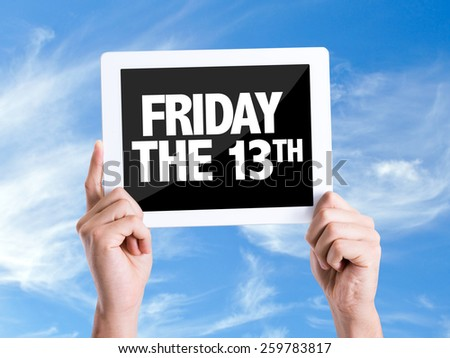Tablet pc with text Friday The 13th with sky background  - stock photo
