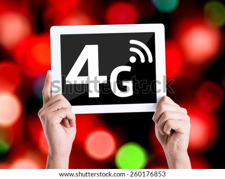 Tablet pc with text 4G with bokeh background - stock photo